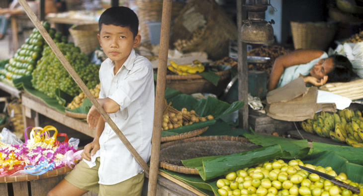 1972 - Thailand - Young Boy In Market with Sleeping Woman
