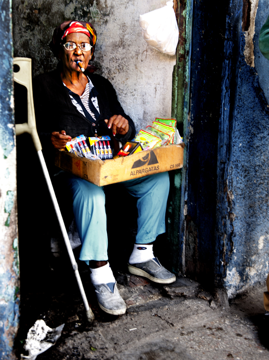 2011-12-01 - Havana Day - Woman Vendor in Doorway Smoking Cigar