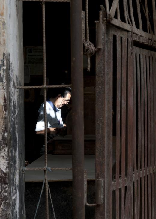 2011-12-01 - Havana Day - Worker Through Wrought Iron Doorway